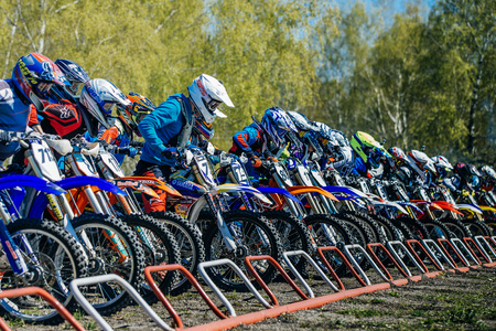sports race: Miasskoe, Russia - May 02, 2016: group of riders on motorcycles on starting line ready to start during Cup of Urals motocross