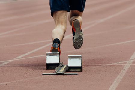 start of sprint athlete men. rear view only legs Stock Photo