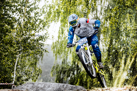 national championship: Magnitogorsk, Russia - July 23, 2016: jump on bike man extreme racer during National championship downhill