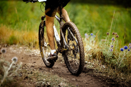 dirty feet athlete sports cyclist and mountainbike covered in mud