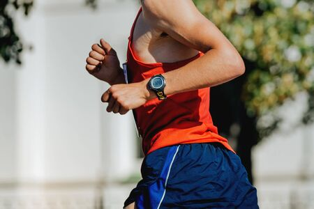 hand watch men runner marathon Stock Photo
