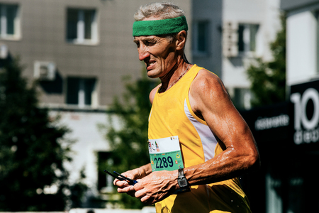 rival rivals rivalry season: Ekaterinburg, Russia - August 7, 2016: closeup of old man runner watch on his arm during Marathon Europe-Asia Editorial