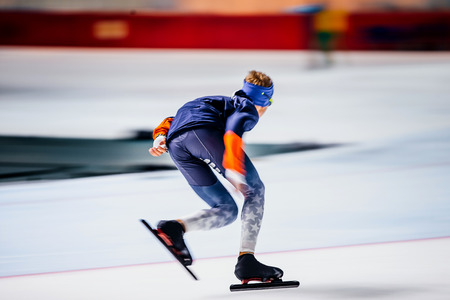 fast running athlete of skater in warm-up before sprint race