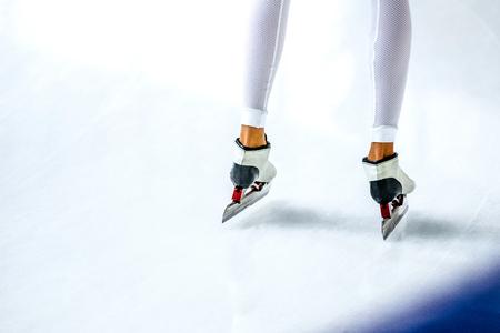 skaters: slender legs girls athletes skaters in white skates and tights