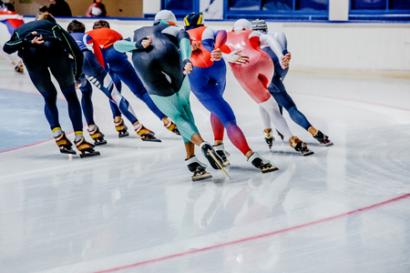 large group of skaters for warm-up race before competitions in speed skating