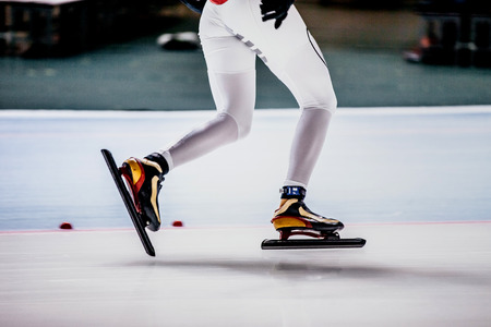 skaters: closeup of legs of women speed skaters at competitions in speed skating Stock Photo