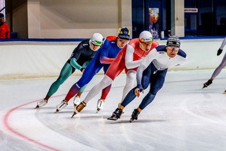 skaters: Chelyabinsk, Russia - August 25, 2016: group of men skaters to warm-up during Summer Cup in speed skating Editorial