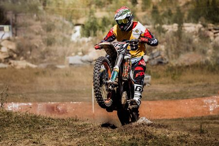 rear wheel: Kyshtym, Russia - August 21, 2016: racer on a motorcycle rides on rear wheel during Ural Cup in Enduro