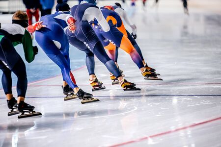 group of men skating on ice sports arena. warm-up before competitions in speed skating Stockfoto
