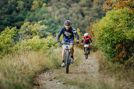 mountainbike: middle-aged man racer cyclist riding uphill during Crimean race mountainbike