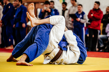 judoka wrestlers man winning throw ippon in judo competitions Stock Photo