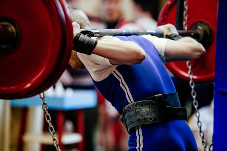 back male powerlifter squat barbell for competition powerlifting Reklamní fotografie