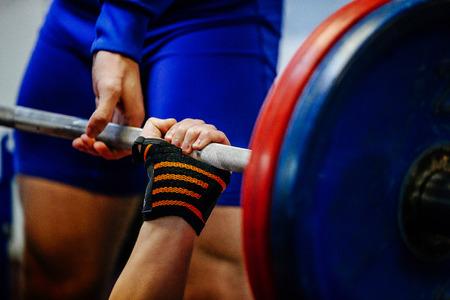 hand wristbands young men powerlifter bench press 스톡 콘텐츠