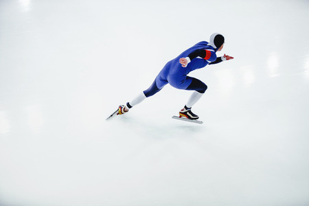 man speed skater in speed skating competitions on white background