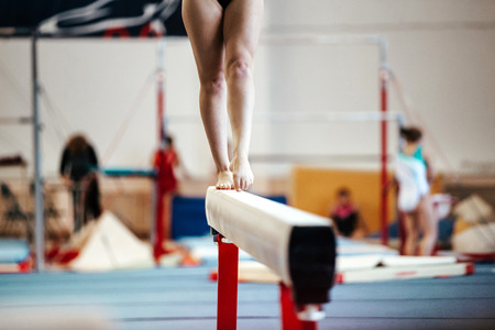 magnesia: female exercises on balance beam competitions in artistic gymnastics