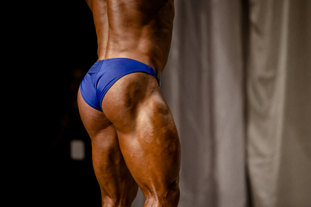back athlete bodybuilder muscular butt and thighs bodybuilding competitions