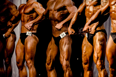group athletes bodybuilders posing most muscular bodybuilding competitions