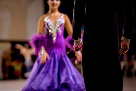 back male dancer athlete in black tailcoat and woman dancer in bright dress Foto de archivo