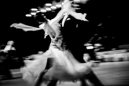 blurred couple dancers competition in ballroom dancing. black and white image Foto de archivo