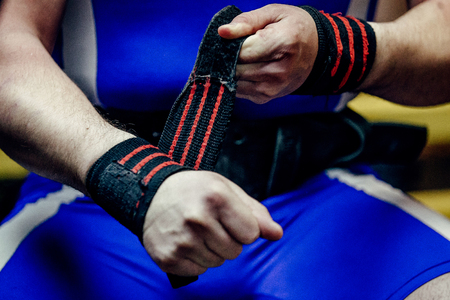 closeup of hands athlete powerlifter in wristbands Stock Photo