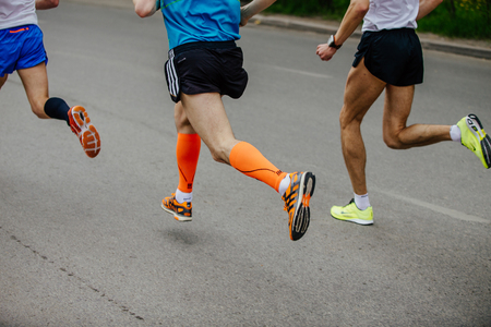 Ekaterinburg, Russia - May 21, 2017: back three men runner running on city street in City half marathon 報道画像