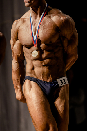 real athlete bodybuilder winner in bodybuilding competitions Stock Photo