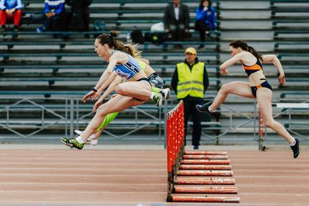Chelyabinsk, Russia - June 4, 2017: women running race in 100 meter hurdles during UrFO Championship in athletics