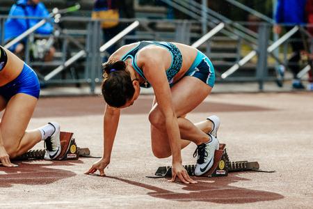 Chelyabinsk, Russia - June 4, 2017: ready start female athlete sprinter run 100 meters during UrFO Championship in athletics