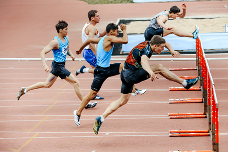 Chelyabinsk, Russia - June 4, 2017: men runners running race in 110 meter hurdles during UrFO Championship in athletics