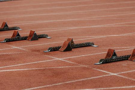 starting blocks on start line of running track stadium Stock Photo