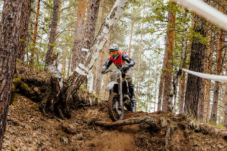 off road biking: motorcycle enduro racing motocross in forest downhill