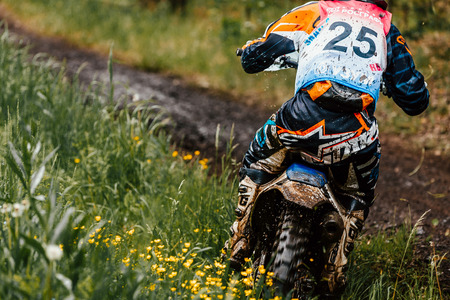 Kyshtym, Russia - June 18, 2017: back athlete bike enduro rides in forest track during Ural Cup in Enduro