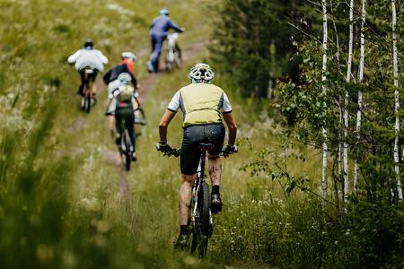 back group men cyclist mountain bike trails