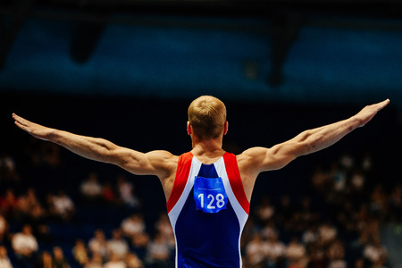 magnesia: floor exercise male gymnast to competition in gymnastics in background is tribune fans Stock Photo