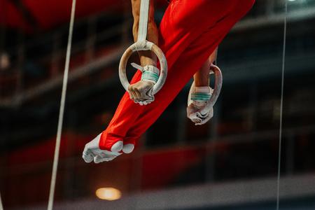 magnesia: feet athlete gymnast still rings exercise in gymnastics