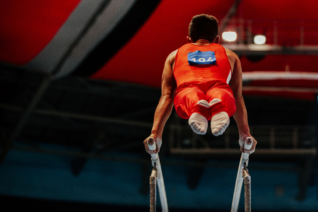 magnesia: parallel bars exercise athlete gymnast to competition in gymnastics Stock Photo