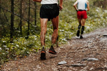 dirty feet runner man running a forest trail
