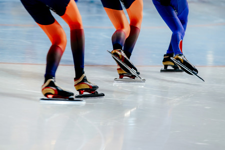 legs women athletes speed skaters in mass start competition Stock Photo