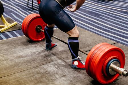 athlete powerlifter training deadlift in sport gym