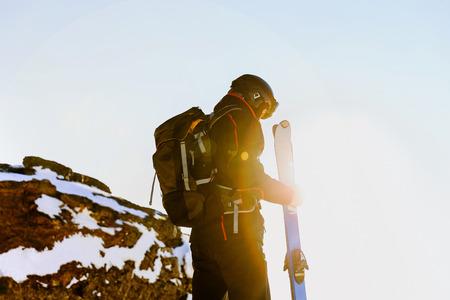 Alpine skiing man athlete skier in bokeh sun
