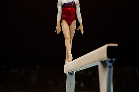 women's artistic gymnastics exercise balance beam