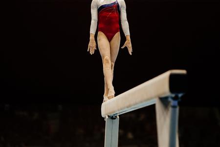 women's artistic gymnastics exercise balance beam