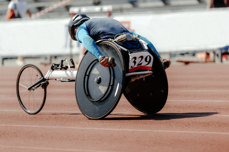 man athlete wheelchair racing and athletics track Stock Photo