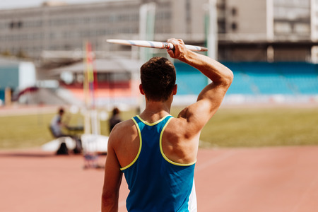 javelin throw back man athlete thrower in track and field Stock Photo