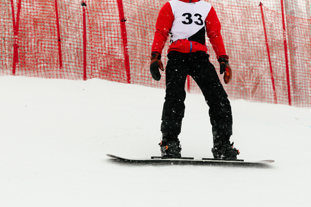 athlete snowboarder riding on track snowboarding competition