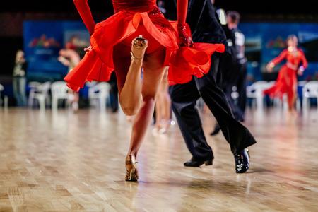 feet of dancers man and woman dancing latin program