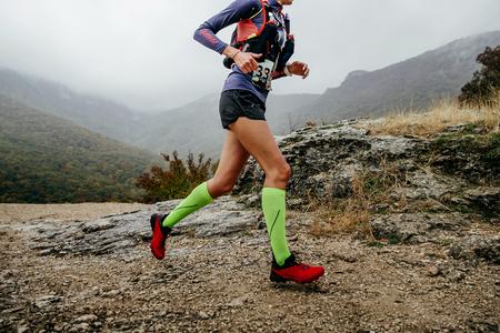 woman runner run mountain race with trail vest for running Reklamní fotografie
