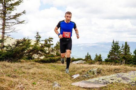 Iremel, Russia - June 1, 2019: male runner running mountain trail on plateau in marathon Healthy as Moose