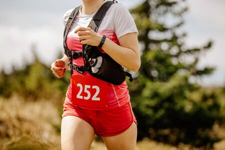 female runner athlete with hydratation cross country running marathon race