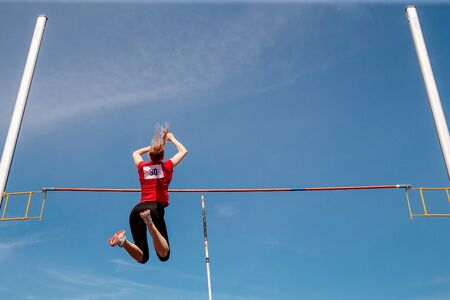 pole vault woman vaulter successful attempt in competition athletics